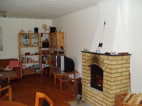 Wohnbereich mit Kamin - Ferienhaus Kallsjö