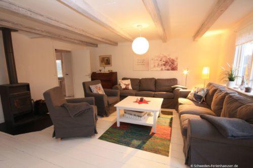 Wohnzimmer mit Kamin – Ferienhaus Ask